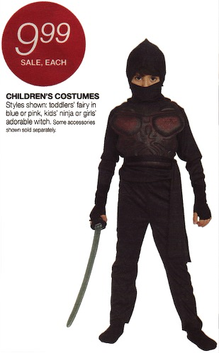 A photo of a kid wearing a really bad ninja costume.