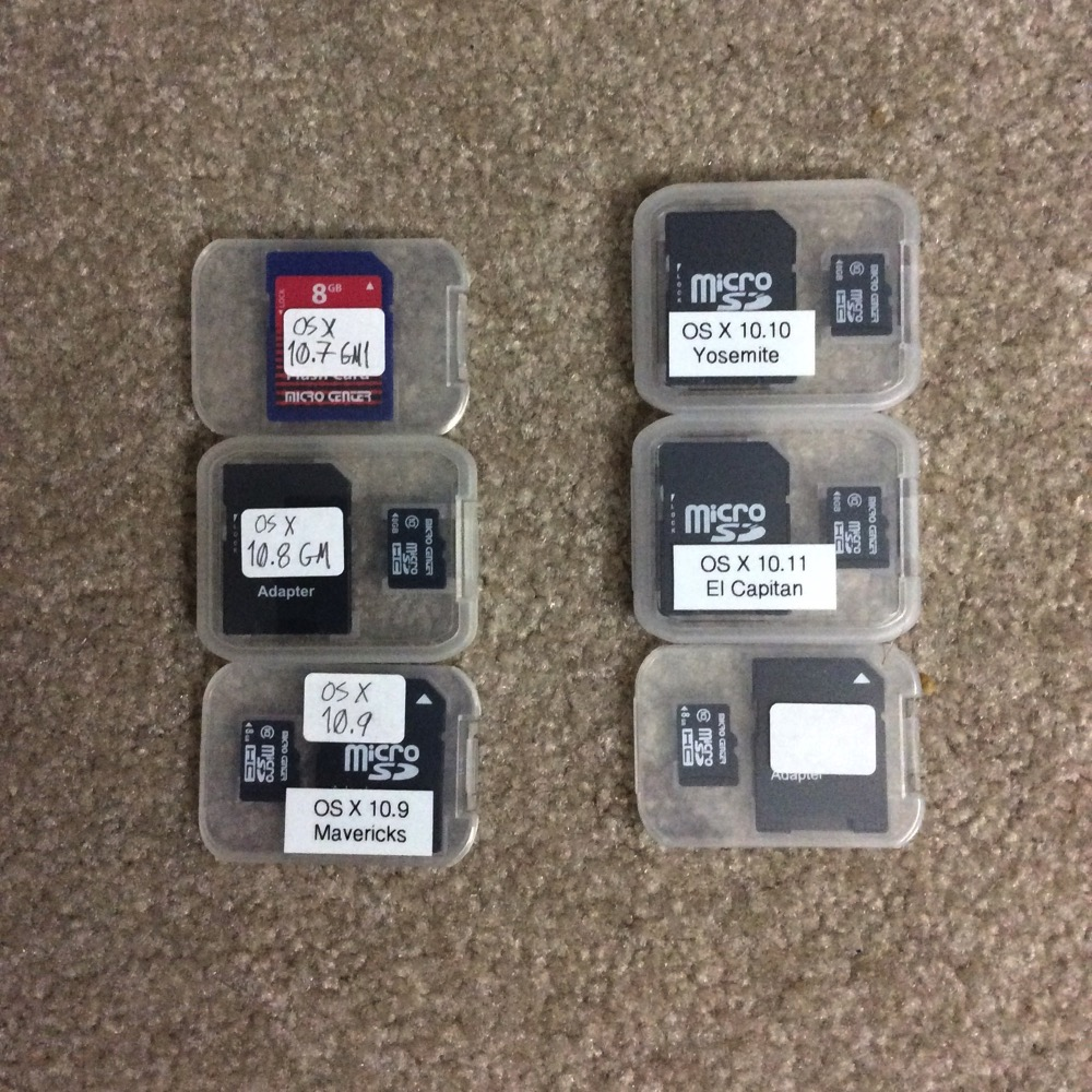 Photo of my flash memory cards on which I have the past several years' macOS installers. Lion was on an SD rather than microSD card; Micro Center have changed their case form factor a few times; I started printing rather than hand-writing labels with 10.9, and I haven't yet labeled the card that will go to Sierra.