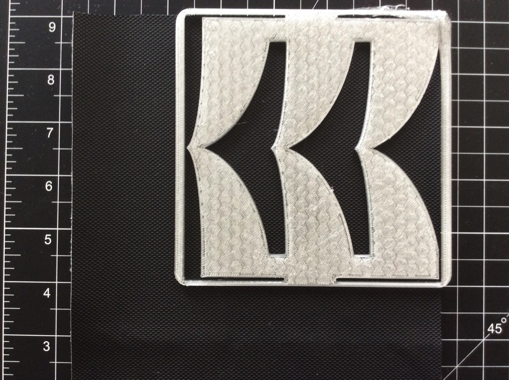 3D-printed template on fabric, awaiting cutting.