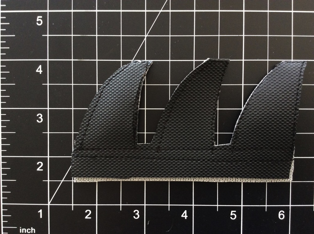 Sewn together: Two parallel seams just below where the fins meet the bottom portion, and one stitch along the perimeter of each fin.